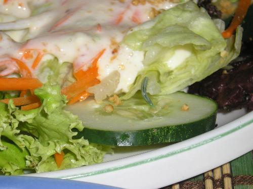 caterpillar on salad - a caterpillar crawling on fresh vegetable salad