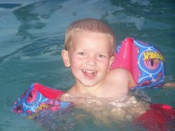 Cade swimming with arm floats - He swims really good with his arm floats. They are Spiderman to match his swim suit and everything else.