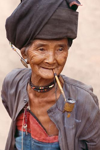 Pipe smoking - An Elderly woman smokng away the day