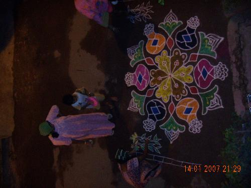 rangoli in my home - On our prime festival Pongal ( practised in Tamilnadu) we did rangoli ...my son very enthusiatic in drawing colours on it..