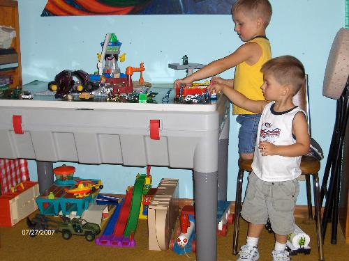 Playing with old toys - My grandsons playing with their daddy's old toys.