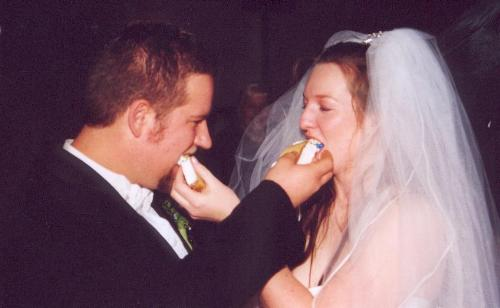 Sharing our first bites of wedding cake - We had a wonderful wedding and deicious cake.