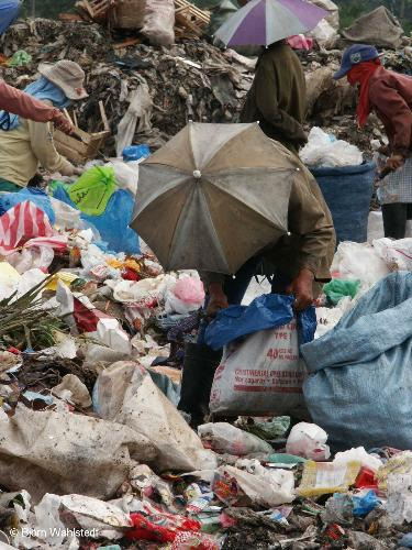 umbrella scavenger. - recycling, another way to earn money.