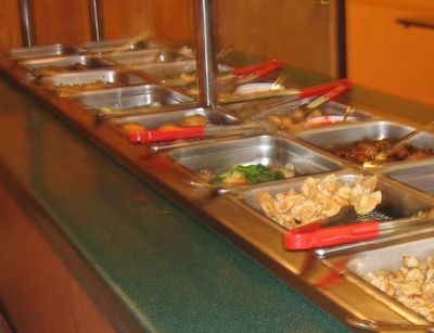 typical buffet - This is a typical set-up of a restaurant buffet table. nice to have the sneeze guards in place to ward off respiratory borne illnesses, but what about hand to hand transfers by using the same utensils over and over person to person?`
