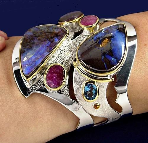 boulder opal and rubies and topaz, sterling silver - sterling and 14K bracelet with 3 big boulder opals, 2 rubies and 2 swiss topaz and several peridots