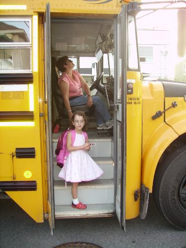 school bus - my daughter getting on the bus for the first day of school