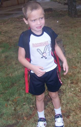 Alex-First day of school - This is a photo of my son, Alex standing in front of the school on the first day of school...he is such a cutie!!