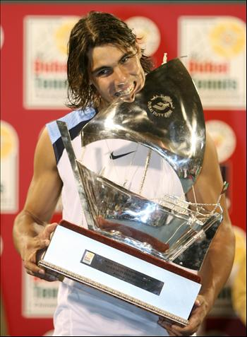 rafael nadal with trophy - rafael nadal biting his trophy. ^__^;;