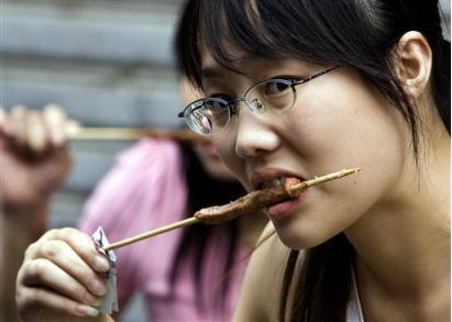 eating food - this is a picture of a woman eating the food she likes.