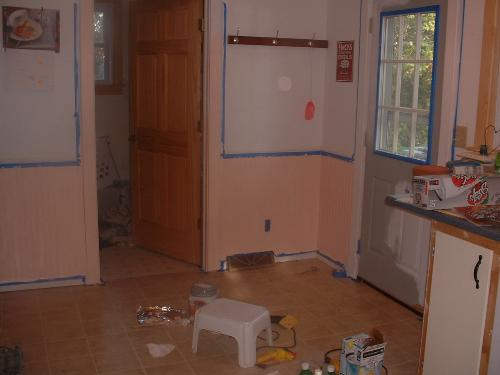 It's PEACH! - My peach kitchen. I still have the walls and doors to paint, but I've gotten the trim work around them painted.