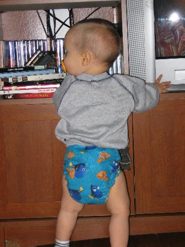 my sweet lil one in a cloth diaper - he loves showing off his nemo diaper