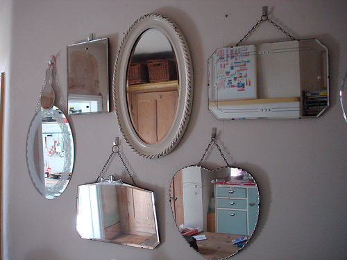 Mirrors - a bunch of mirrors hanging on a wall