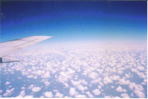 a view from an airplane - above the clouds