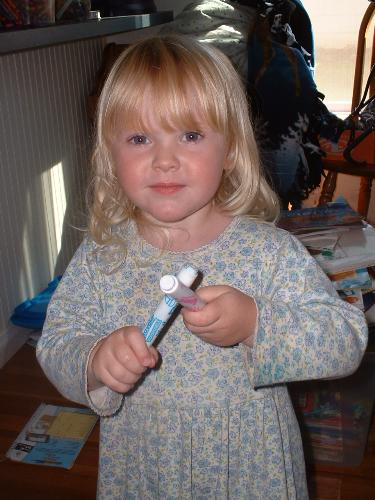 Megan playing her violin - I wanted to share this. What imagination little girls have. These markers were her violin.