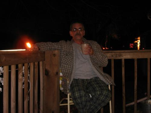 One More Night? - Me sitting outside having coffee on my deck