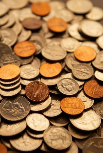 spare change - extra money that can come in handy when you lest expect it. Like times when your low on gas, or need a little more to buy yourself lunch.