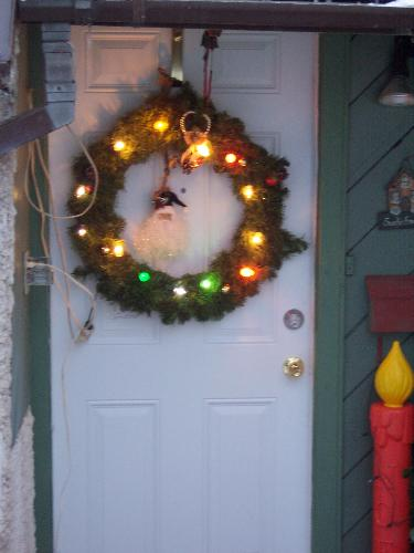 Christmas is coming...our door with a wreath - We decorate our house every Christmas. This is a photo of our front door with a wreath.