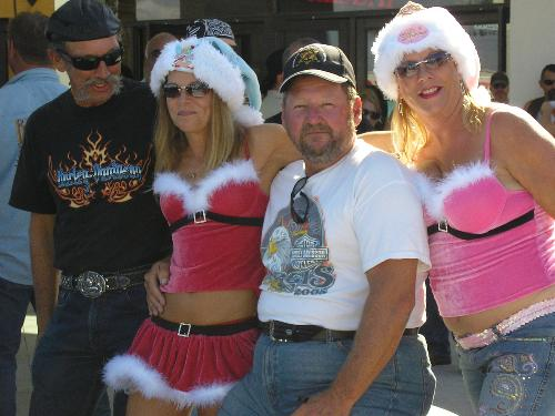 Santa's Helpers - He has plenty of helpers to do all his work for him. With those helpers most guys would just kick back and watch wouldn't they?