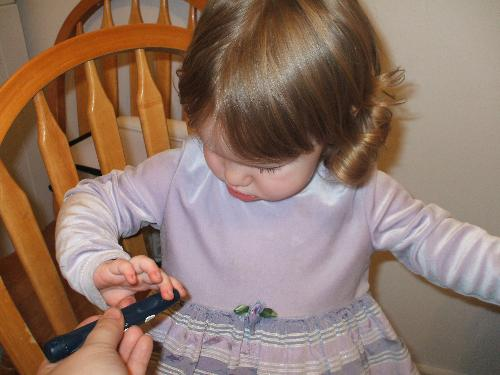 My daughter getting her finger poked - Here is a picture of my little girl, we are checking her sugars