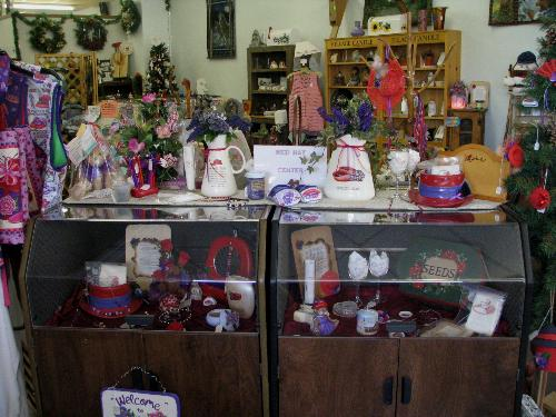 Hand crafted gift shop - This is a picture of part of my hand crafted gift shop. I opened the shop as an outlet for my creative endevors and then invited other crafters to display and sell their items in my shop as well. People have said they love the shop because they know they can get a unique gift items there that they would not find anywhere else and they don't have to worry if the person already has it since many of our items are one of a kind.