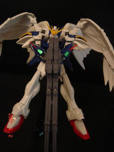 Wing-Gundam Zero Custom - Wing Gundam spreading its wings and getting ready to blast from his blaster gun. . . ready ready~!!