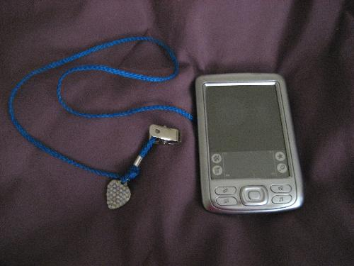 My PDA with its own BLING! - My beloved Palm Zire 72 complete with tether, clip, and its own jewelry.