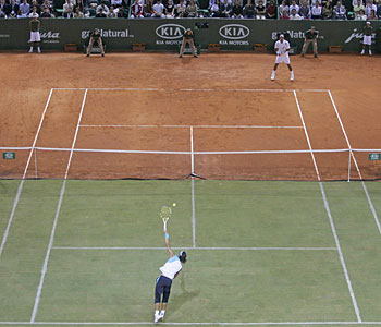 Federer Vs. Nadal - A picture of Roger Federer against Rafael Nadal on a dual surface court