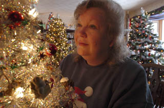 The Christmas Tree Addict  - image of the woman with 42 trees at Christmas