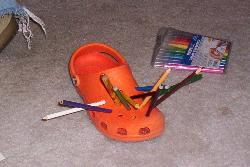 Pencils and Pens in a Shoe - My son stuck pens, pencils and markers in a friend's shoe.