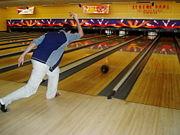 Bowler - Man releasing bowling ball