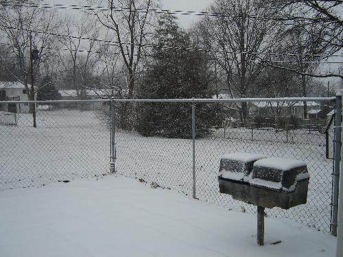 Photo of snow taken this afternoon - Photo of a small portion of our backyard