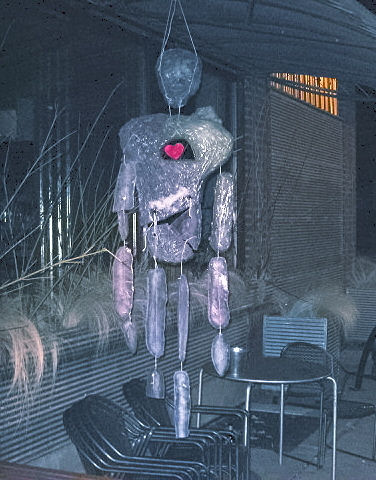 Ice Sculpture - A human form hanging from the patio area of a local coffee shop in Minneapolis Minnesota USA.