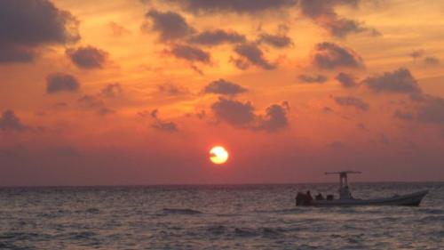 Sunset Isla Mujeres - From Cancun, the sunset is not visible. Must view from Isla Mujeres or Cozumel. Typical gorgeous happy hour sunset.