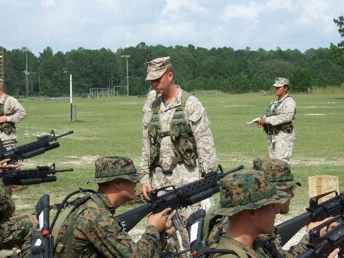 What I do now - This is me in front of some students teaching them about the M-203 Grenade launcher.