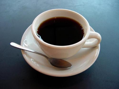 Coffee cup - cup of coffee and a spoon