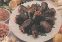 mahshe batenjan - picture of (mahshe) this is the way we cook the eggplant , we stuff it wih meat and rice ..