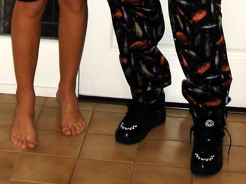 Do you wear shoes at home? - A picture of 2 pairs of legs. One with shoes and one without - barefooted. Photo source: http://farm1.static.flickr.com/28/49588015_557381f191.jpg?v=0 .