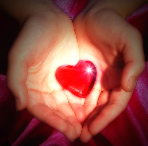 Posting discussions is good karma? - A picture of someone holding a heart. Photo source: http://farm1.static.flickr.com/168/374268661_c63d40d3b5.jpg?v=0 .