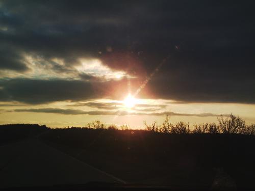 Sun peeking under the clouds - March 6, toward sundown.