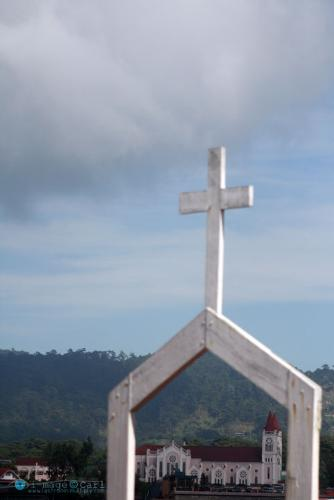 Baguio Cathedral - Framed with another church's cross. Baguio Cathedral has become the center of worship for catholics in the City for decades.
