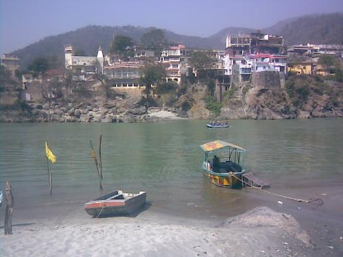 Boating and rafting at Ganga - People do voting and rafting in Ganga at Rishikesh