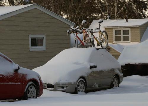 Winter Snow Strom - I was struck by the contract suggested by this situtation. You have the bicycles on the car roof suggesting a spring bike ride with everything covered in snow.