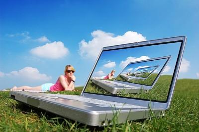 laptop pc - A laptop pc on the grass