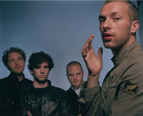 Coldplay - Chris Martin in shines in the forefront while his bandsmates stand behind