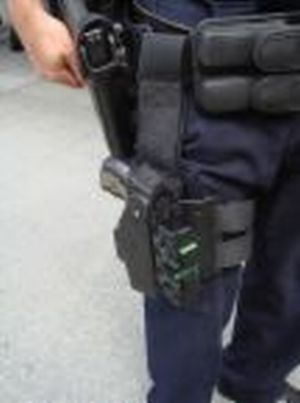 Police Tazers - A picture of a policeman with a tazer gun strapped to his leg.