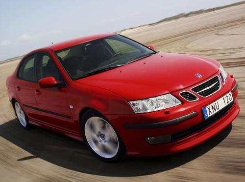 Beautiful red Saab 2007. - Standard car shot racing through rugged terrain. By turning at a rapid rate of speed, the car manufacturers can demonstrate how the car handles.