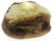 Baked Potato - A potato that is cooked in the form of baking either in an oven or on a grill.