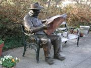 reading newspaper - reading newspaper in the garden