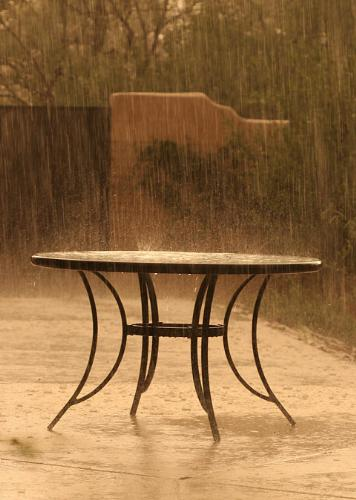Rain- But where are the lovers? - this photograph is of a table where the lovers had broken up for the first time.