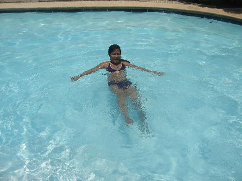 swimming in the pool - this is my way of losing weight swimming everyday in the pool but I'm just woried becuase the more I went into swimming the more I get my skin darker